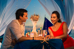 Young beautiful couple have a romantic dinner at sunset royalty free stock photos