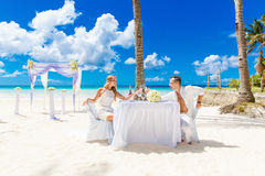 Young beautiful couple have a romantic dinner on a tropical beac Stock Photos