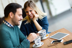 Young beautiful couple having date in coffee shop Stock Photos