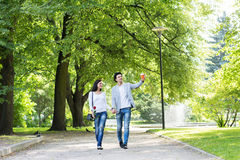 Young beautiful couple having a date in the park Royalty Free Stock Photos
