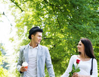 Young beautiful couple having a date in the park Stock Images