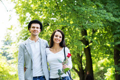 Young beautiful couple having a date in the park Royalty Free Stock Images
