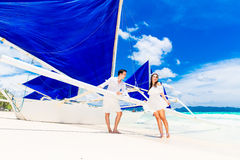 Young beautiful couple having fun on a tropical beach . Tropache Royalty Free Stock Images