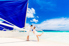 Young beautiful couple having fun on a tropical beach . Tropache Royalty Free Stock Photography