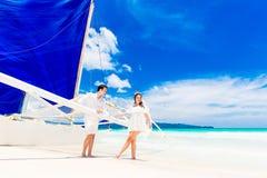 Young beautiful couple having fun on a tropical beach . Tropache Stock Photo