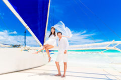Young beautiful couple having fun on a tropical beach . Tropache Stock Image