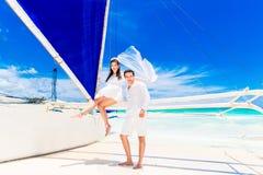 Young beautiful couple having fun on a tropical beach . Tropache Stock Image