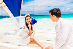 Young beautiful couple having fun on a tropical beach . Tropical Royalty Free Stock Image