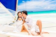 Young beautiful couple having fun on a tropical beach . Tropical Royalty Free Stock Photos