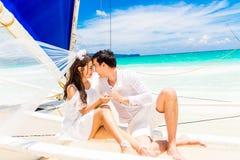 Young beautiful couple having fun on a tropical beach . Tropical Stock Photo