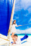 Young beautiful couple having fun on a tropical beach . Tropical Stock Photos