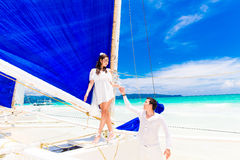 Young beautiful couple having fun on a tropical beach . Tropical Stock Photography