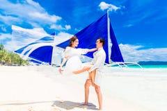 Young beautiful couple having fun on a tropical beach . Tropical Stock Image