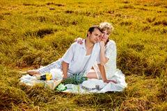 Young beautiful couple having picnic Stock Photo