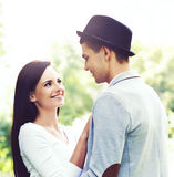 Young beautiful couple of hipsters: hugging in the park. Royalty Free Stock Image