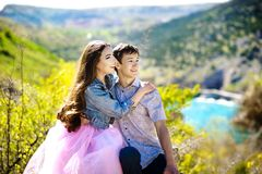 Young beautiful couple of hipsters: walking in the park. Love, relationship, dating: concept. royalty free stock images