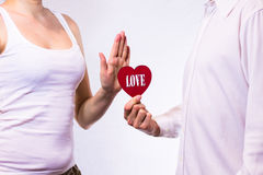 Young beautiful couple holding red heart stock photography