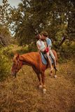 Young beautiful couple  with a horse. Filtered. Selective focus. Royalty Free Stock Images