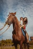 Young beautiful couple  with a horse. Filtered. Selective focus. Stock Images