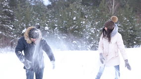 Young beautiful couple hug in winter forest stock video