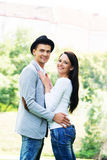Young beautiful couple hugging in the park Royalty Free Stock Images