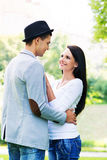 Young beautiful couple hugging in the park Stock Photo