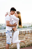 Young beautiful couple hugging and about to kiss Stock Images