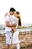Young beautiful couple hugging and about to kiss Royalty Free Stock Photo