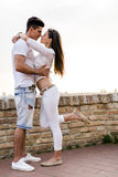 Young beautiful couple hugging and about to kiss Stock Photography