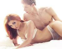 Young and beautiful couple in lingerie  on white Stock Photos