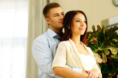 Young beautiful couple looking away Stock Photography
