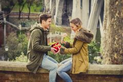 Young beautiful  couple in love celebrating Valentines day presents Stock Photos
