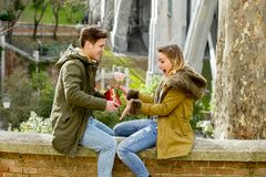 Young beautiful  couple in love celebrating Valentines day presents and rose Stock Image