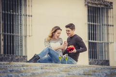 Young beautiful  couple in love celebrating Valentines day presents and toast Stock Photo