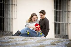 Young beautiful  couple in love celebrating Valentines day presents and toast Stock Images