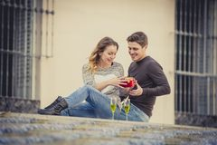 Young beautiful  couple in love celebrating Valentines day presents and toast Stock Photography