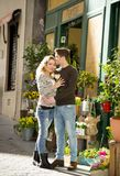 Young beautiful  couple in love kissing on street celebrating Valentines day with rose gift Royalty Free Stock Photos