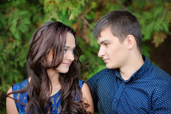 Young beautiful couple in love on nature together Stock Photos