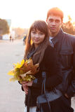 Young beautiful couple in love outdoor backlit Royalty Free Stock Photography
