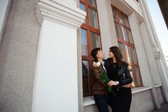 Young beautiful couple in love posing outdoor in city. Young woman smiling with her handsome man. stock images