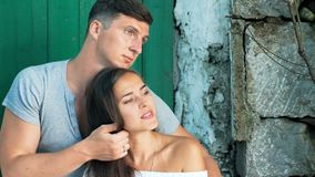 Young beautiful couple in love sitting on old city street, summer Europe vacation stock video