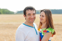 Young beautiful couple in love standing embracing Stock Images