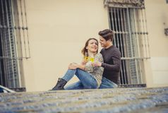 Young beautiful couple in love on street together celebrating Valentines day with Champagne toast Stock Photography