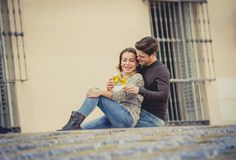 Young beautiful couple in love on street together celebrating Valentines day with Champagne toast Royalty Free Stock Photography
