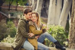 Young beautiful couple in love on street together celebrating Valentines day with Champagne toast Stock Image