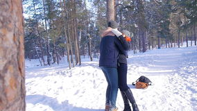 Young and beautiful couple in love walking in the winter woods