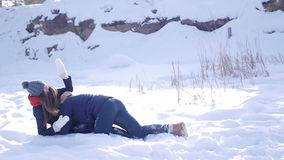 Young and beautiful couple in love walking in the winter woods stock video footage