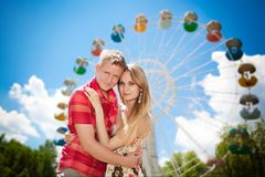 Young beautiful couple lovers in the park Stock Photo