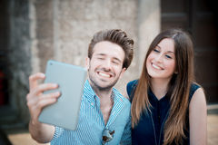 Young beautiful couple lovers using tablet Stock Photo
