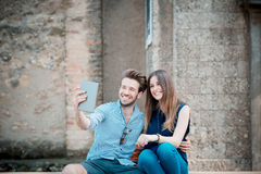 Young beautiful couple lovers using tablet Stock Photos
